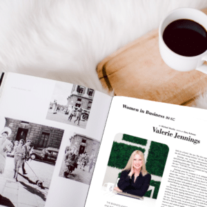 a cup of coffee and a magazine featuring Valerie Jennings