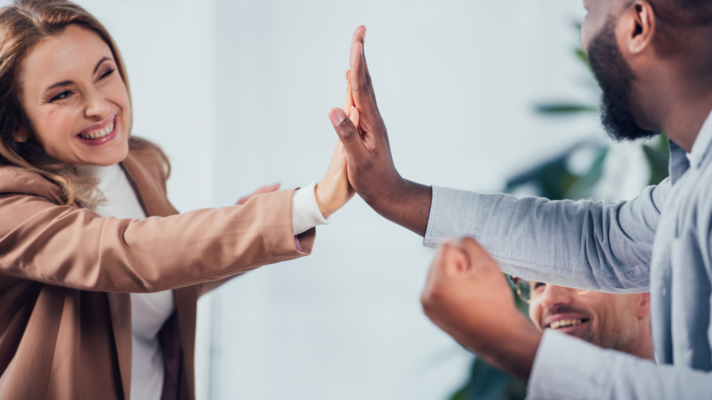 Diverse professionals happy giving high fives